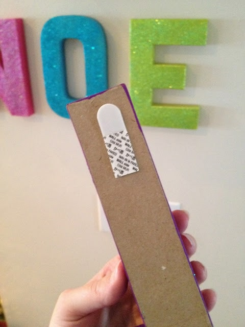 Command strip to hang cardboard letters