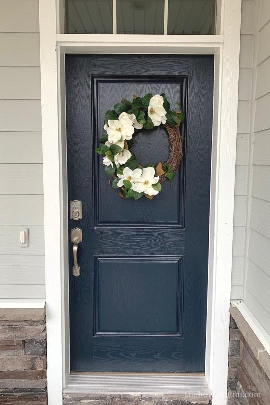 Navy door with magnolia wreath