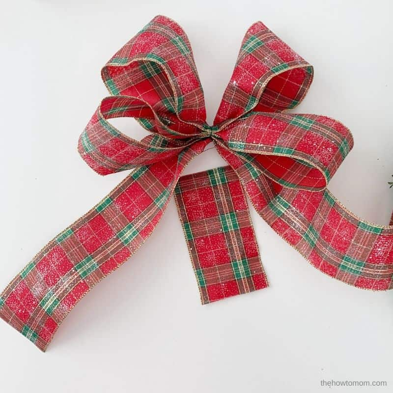 use a piece of ribbon to cover the center of the bow