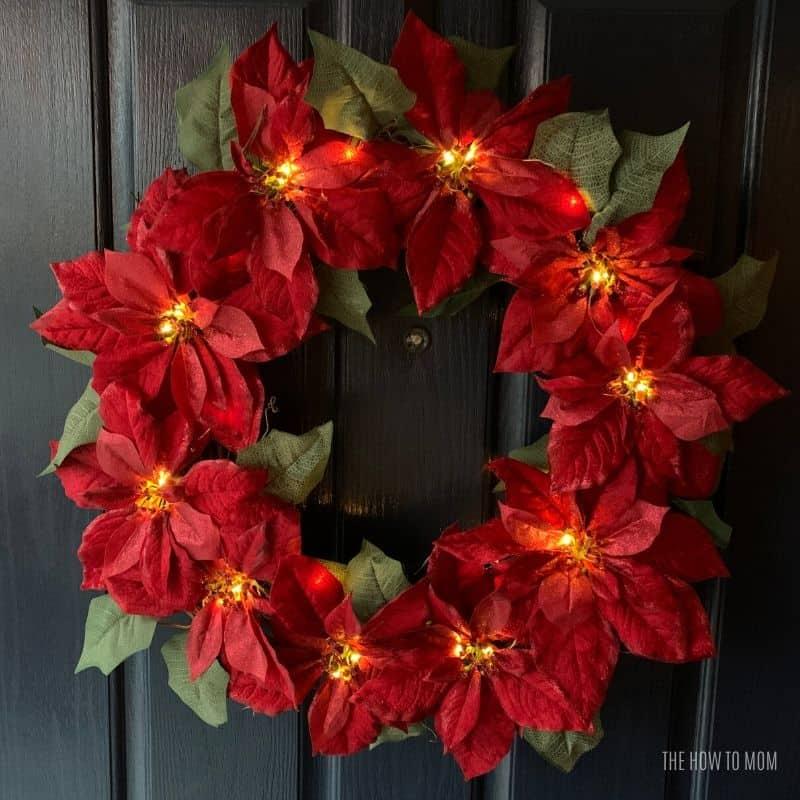 fairy lights on a red poinsettia wreath