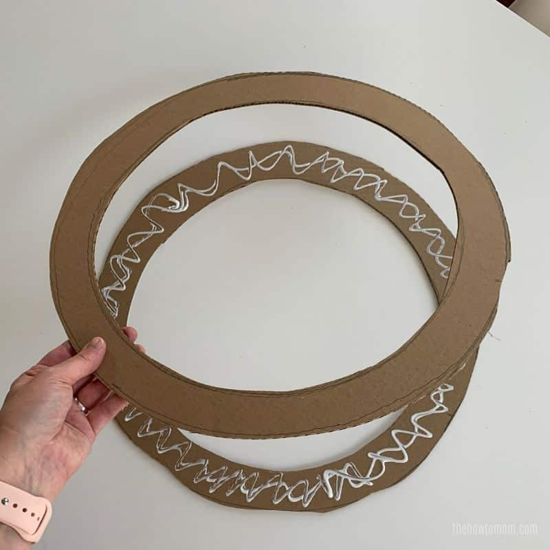 glue cardboard together to make a wreath