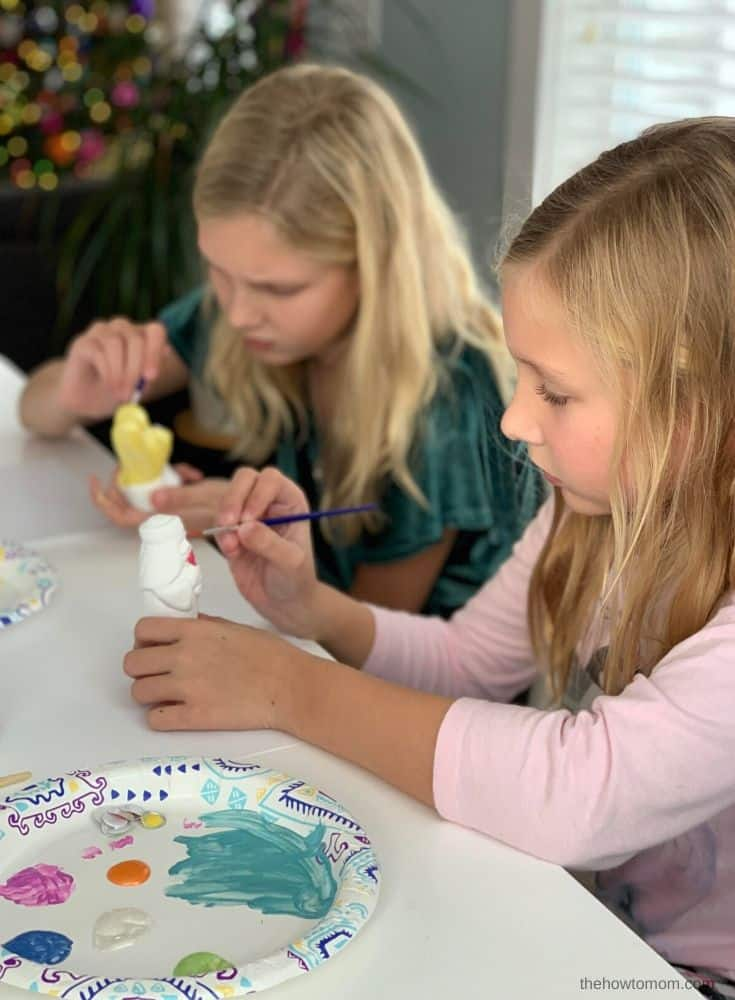 kids painting nativity set