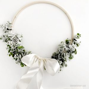Eucalyptus wreath with flocking and white satin bow