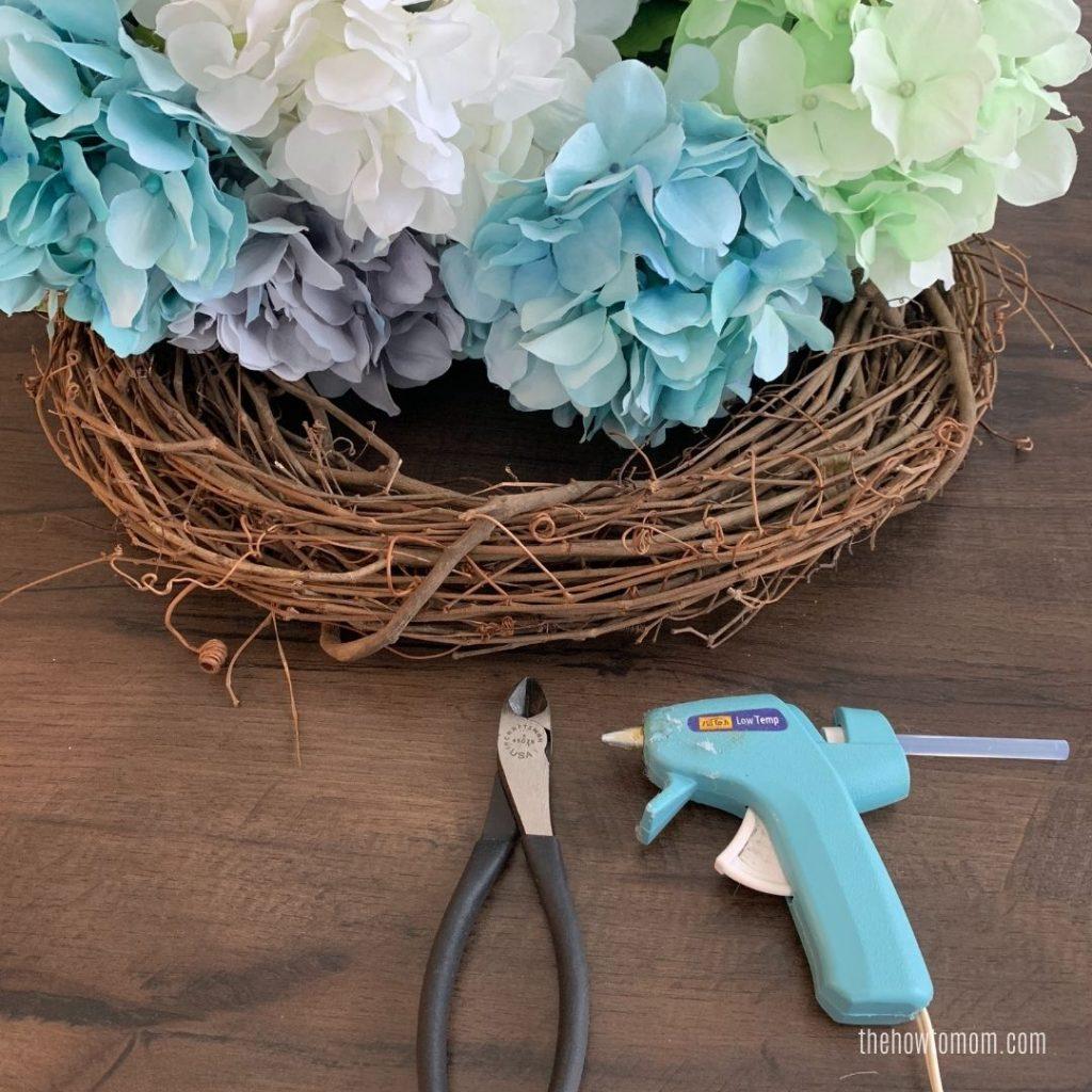 wire cutters, hot glue gun, grapevine wreath and hydrangea blooms